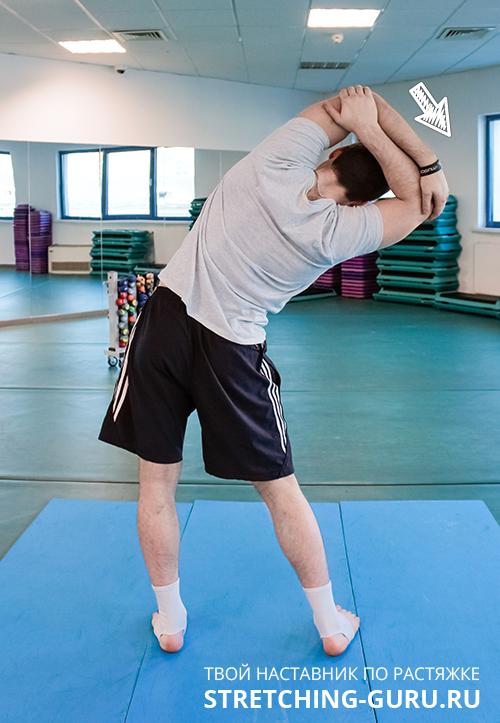 Упражнение для растяжки мышц подмышечной области и плеча.